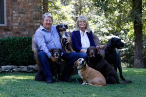 Chef Walt Dotson with his wife and their four fur babies